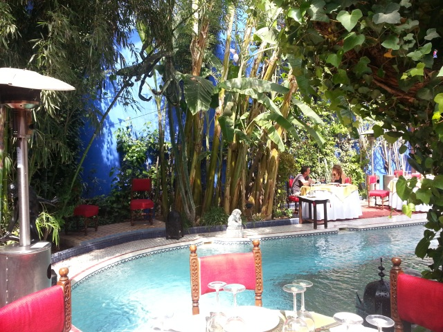 The courtyard offers fine dining around the lovely pool