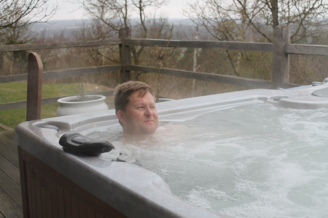 Espen enjoying the outside spa pool a must on every visit.