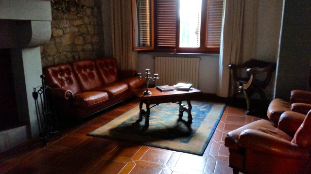 sitting area, been updated with a new leather sofa